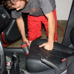 Allen West the shop manager at VehicleSpa begins to remove the seats from the car to gain full access